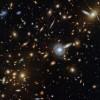 星系动物园:哈勃捕捉到一个由各种形状和大小星系组成的星系团