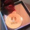 司机捡到全运会金牌:误以为是月饼
